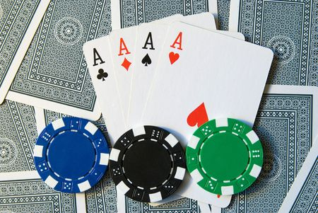 Playing Cards with 4 aces and poker chips