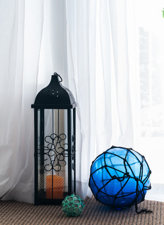 appliance: Hurricane lantern with net floats Stock Photo