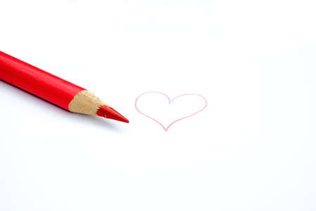 red pencil: Red pencil drawing a heart