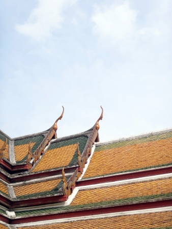 gable apex decorated by pieces of color grass crafte on the roof of Thai temple            Stock Photo