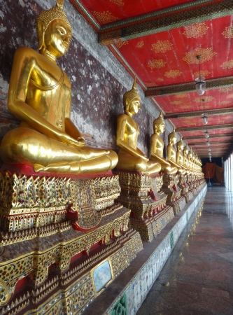 perspective of golden statue  Buddha place in square balcony of Thai temple Stock Photo