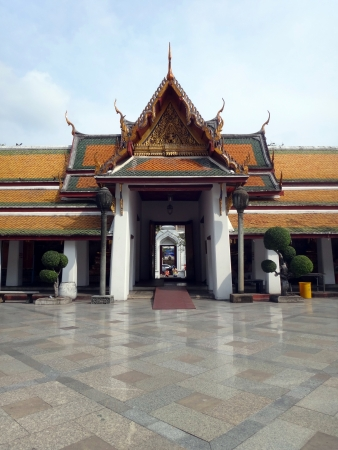front view of the inner balcony gate of Thai temple with clear sky background     Stock Photo