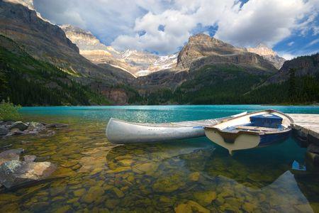 Aluminum canoe and a boat on a mountain lake