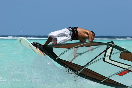 A freestyle windsurfer performing an areal