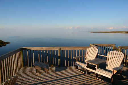 A water-front deck in a sunny afternoon