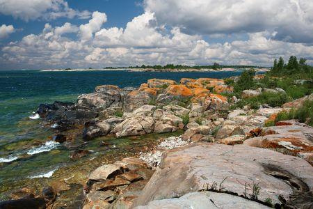 Rocky island on a lake with dramatic sky. Georgian Bay, Ontario, Canada