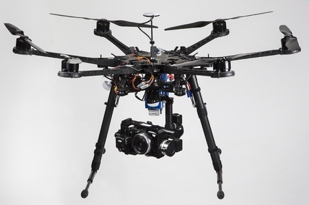 A hexacopter with attached camera isolated on a white background