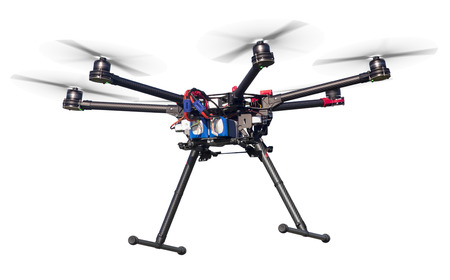 A flying hexacopter with a white background. Includes clipping path