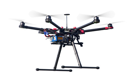 A flying hexacopter with spinning propellers without a camera shot from side isolated on white Standard-Bild