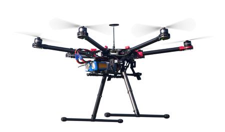 Ein fliegender Hexacopter mit Spinn Propeller ohne Kamera Schuss von der Seite isoliert auf weiß Lizenzfreie Bilder