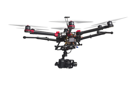 A flying helicopter with raised landing gears and a camera isolated on white background. Includes clipping path. 스톡 콘텐츠