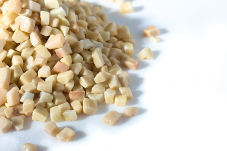 beautiful natural yellow stone scattered on a white