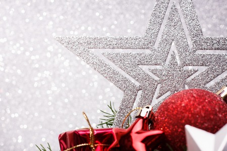 Christmas composition of Christmas tree toys on a silver background. Stock Photo