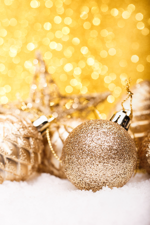 Christmas composition of Christmas tree toys on a gold background. Stock Photo