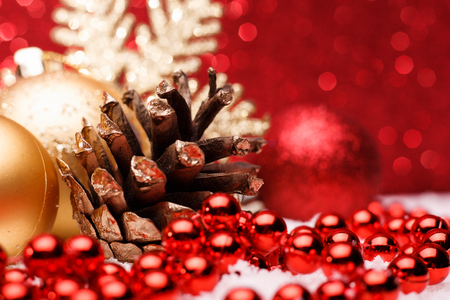 pinecones: Christmas composition of Christmas tree toys on a red background.