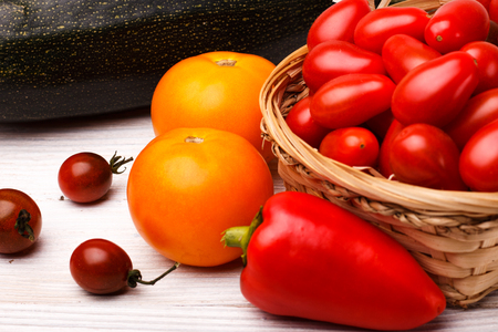 fresh farmyard vegetables on the rustic background. Stock Photo