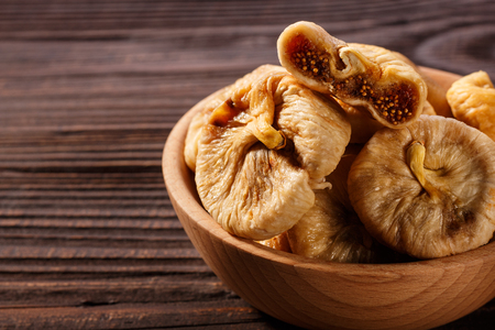Dried figs on a dark rustic background. 写真素材