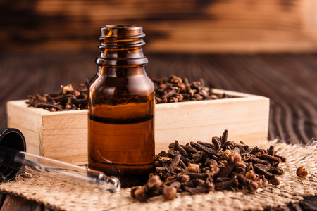 essential oil of cloves on a wooden rustic background. Stok Fotoğraf