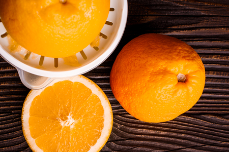 oranges and juice on a wooden background. Stock Photo