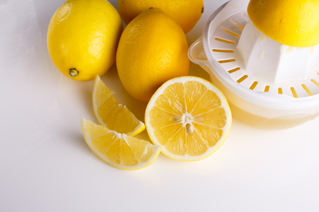 Lemon and juice on a white background. Stock Photo