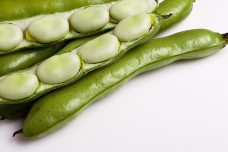 fresh broad beans on a white background. Stock Photo