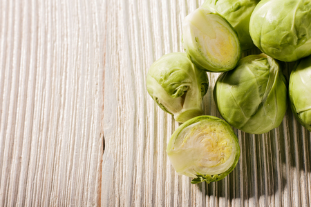 Brussels sprouts on a rustic wooden background.