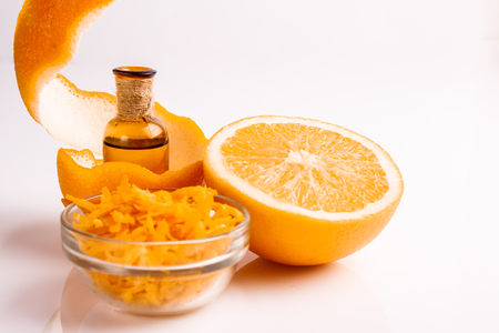 orange essential oil on a white background.
