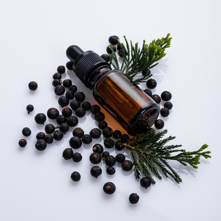 juniper essential oil on a white background.