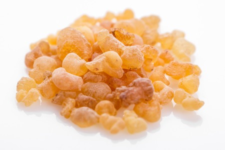 fragrant frankincense on a white acrylic background. Stock Photo