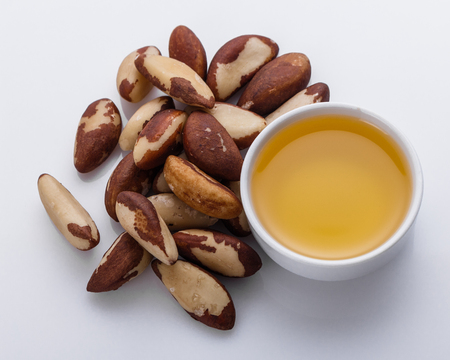 brazil nut on a white acrylic background. Stock Photo