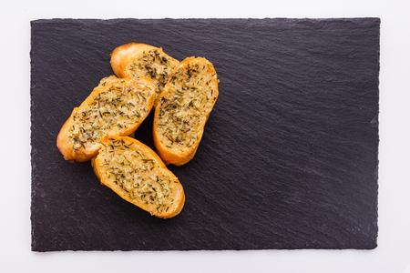 fragrant garlic bread on a white acrylic background.