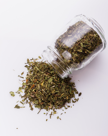 dried tarragon and essential oil on a white background. 免版税图像