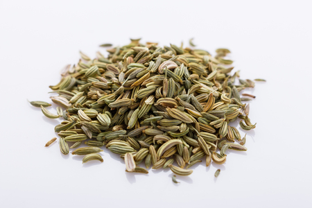 essential oil of fennel seeds on a white background.