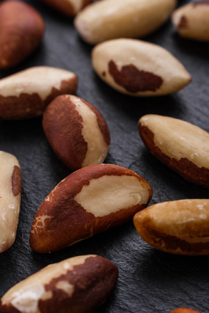 brazil nut on a dark stone background. Imagens