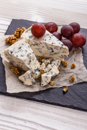 delicious blue cheese on wooden rustic background.