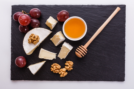 delicious creamy camembert cheese on a white background.