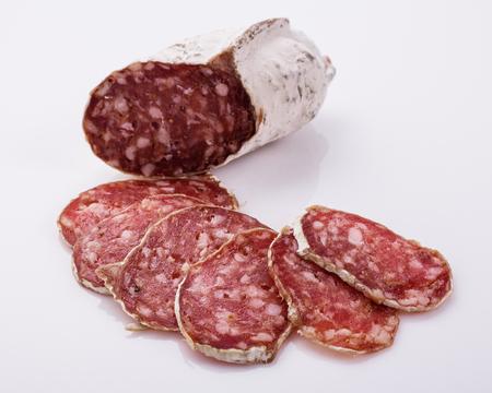 Saucisson sec delicious french salami on a white background. 免版税图像