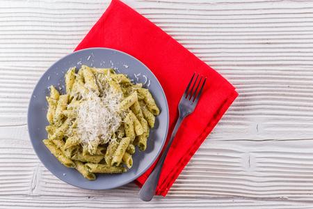 pasta pesto on a white wooden background. Stock Photo