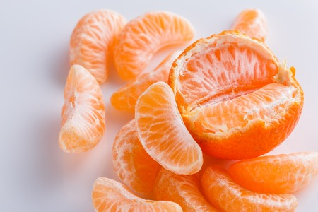 juicy mandarin on a white acrylic background.
