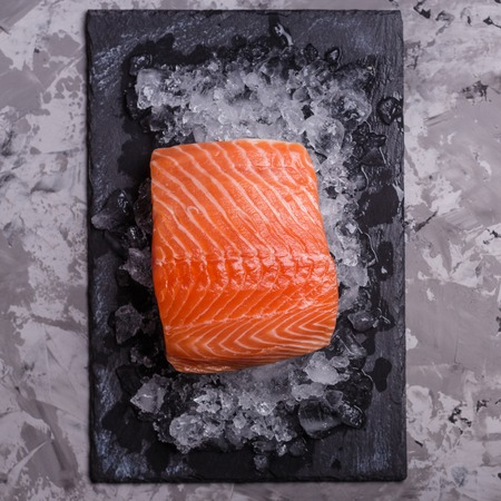 chilled salmon fillet on a gray stone background. Imagens