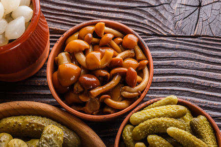 pickled vegetables on a wooden rustic background.