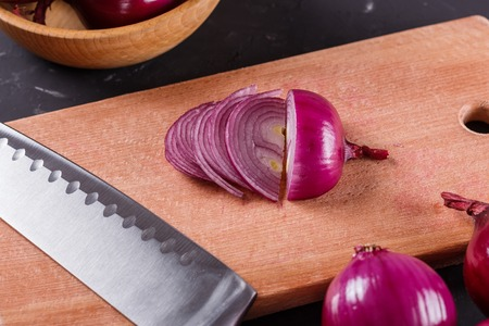 red onion cut on a wooden board.