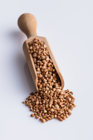 Grain buckwheat on a white acrylic background.