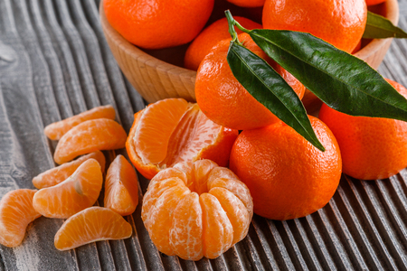 juicy mandarin on a gray wooden rustic background.