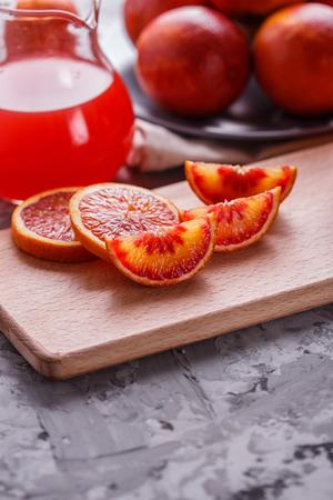 blood orange and juice on a dark background.