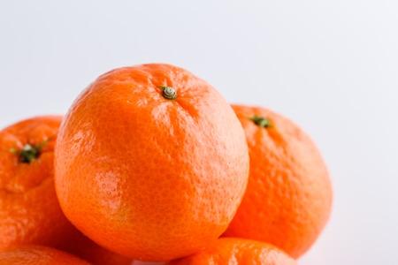 juicy mandarin on a white acrylic background. Standard-Bild
