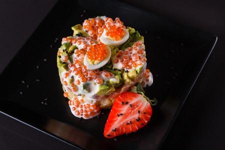 Round salad made of red fish potato and avocado. Standard-Bild - 124194132