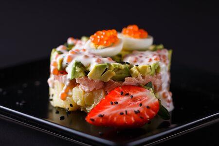 Round salad made of red fish potato and avocado. Imagens