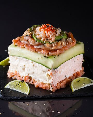 Piece of traditional savory swedish sandwich cake Smorgastorta with a caviar, mayonnaise, cucumber, square format Standard-Bild - 124900974