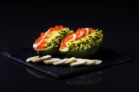Avocado with banana caviar and shrimp.